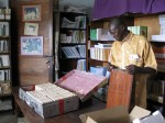 Clément Nzungu Mavinga prepares a reference library for a nursing school