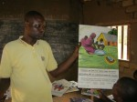 An educational poster box in use in a school in the DRC